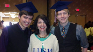 Capping two of my students at their Senior Breakfast in 2014